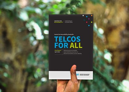 Person holding Telcos for All brochure up for display